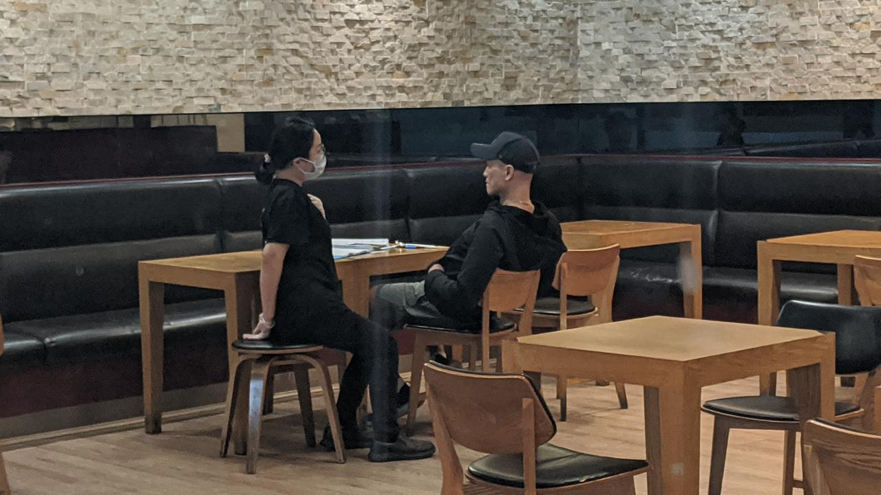 The owner of Madtongsan IV Korean restaurant at Sunnybank's Market Square (right) in conversation with an employee.