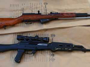 Semiautomatic rifle, drugs allegedly found in police search