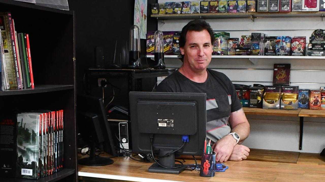 Craig Driver mans the counter at his shop, Grim Games and Hobbies. Photo: Pollymiss Photography