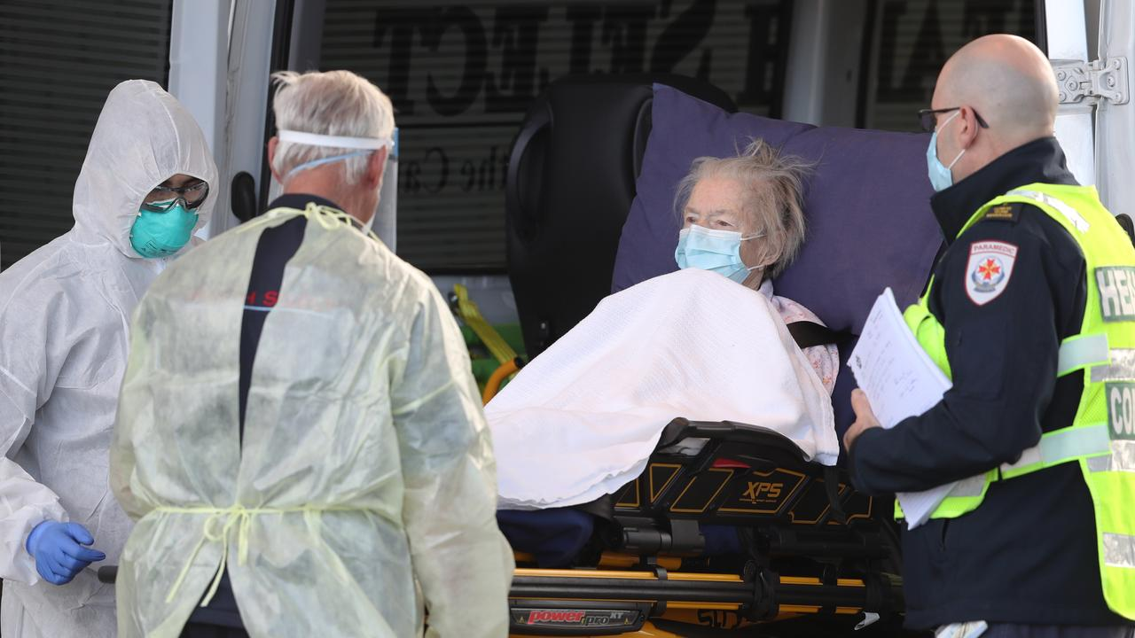 A resident is transported out of Epping Gardens Aged Care home which has a COVID-19 breakout. Picture: NCA NewsWire /David Crosling