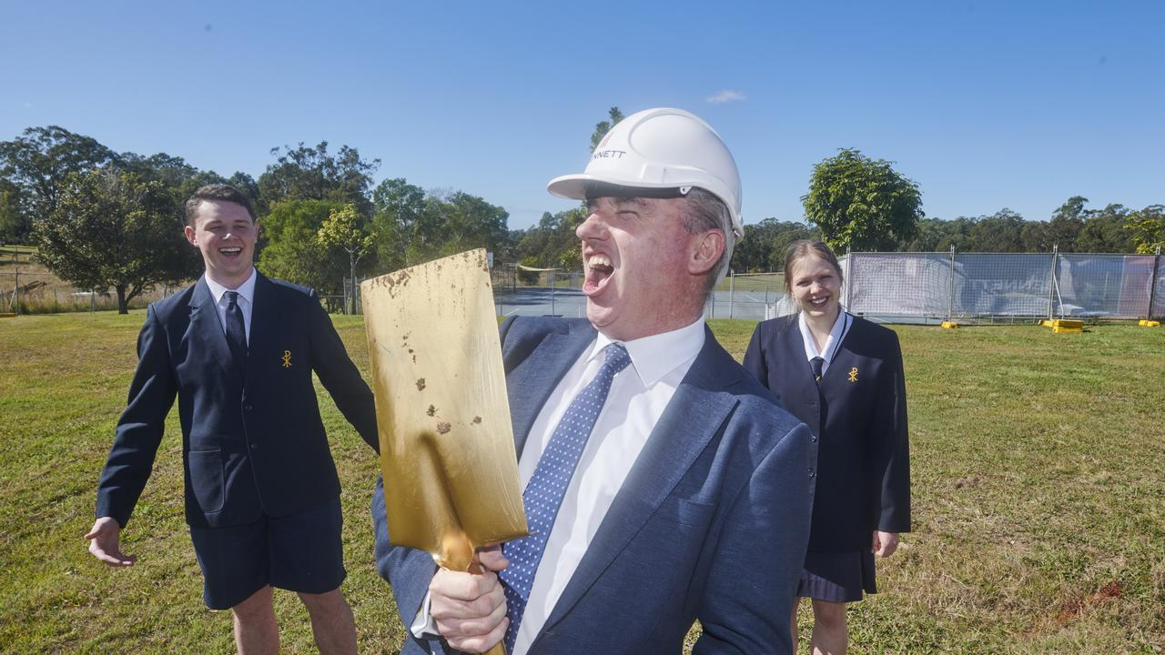 Member for Page Kevin Hogan belts out a tune after turning the first sod on the Clarence Valley Anglican School's new performing arts centre as the school's leaders look on.