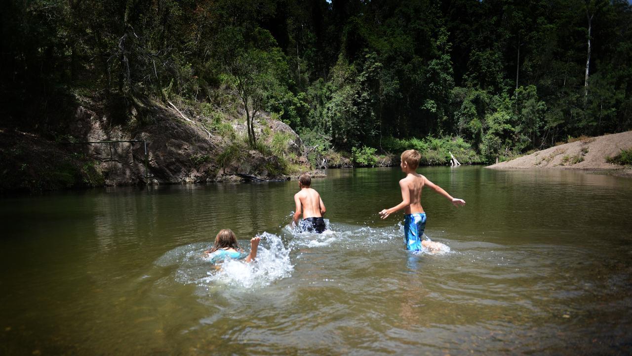 Lauren Le Clerk, Jack McNamara and Joel Le-Clerk enjoy the water hole at Cedar Grove
