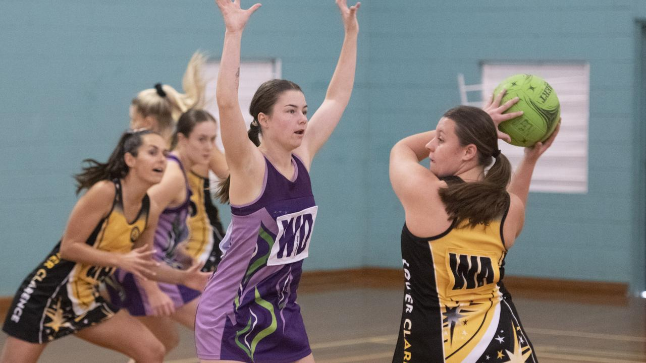 Action from 2019 regonal netball open semi-final between Lower Clarence and Grafton at Grafton Sports Centre.