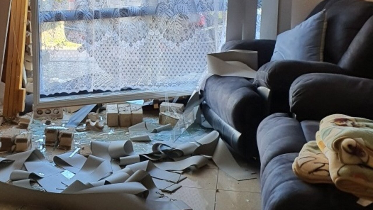Rubble, bricks, glass and concrete were strewn across the loungeroom floor.