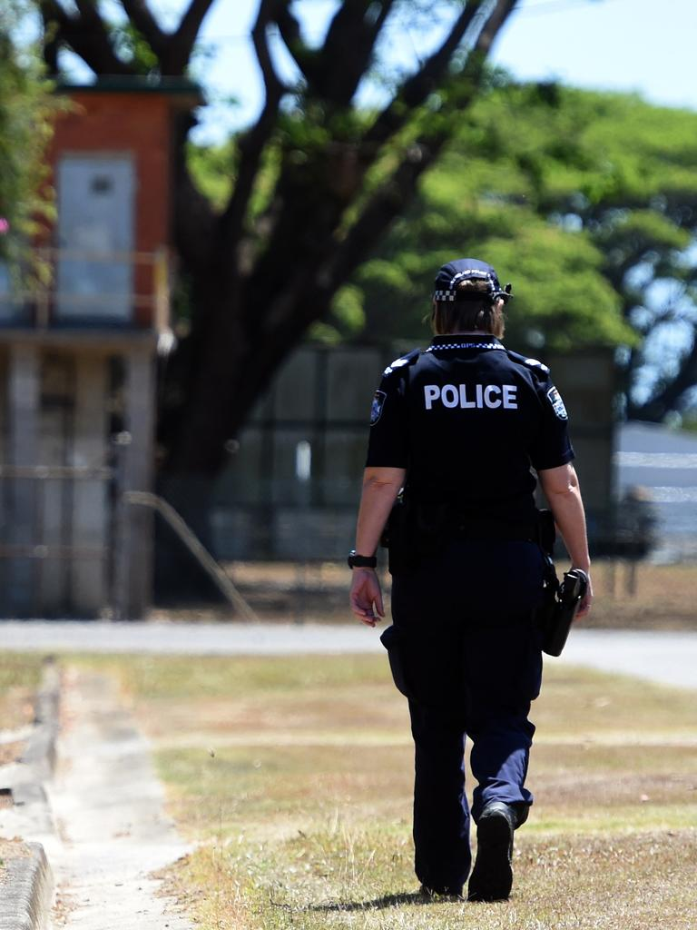 Police walk down Conroy Street, Ingham to speak with neighbours after Mr Godbold was found dead. Picture: Zak Simmonds