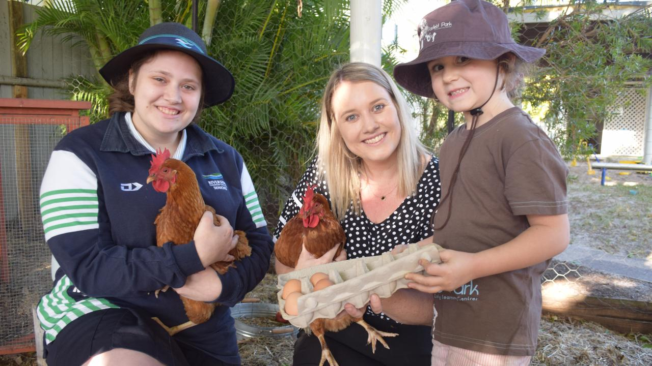 Year 12 Riverside Academic Prefect Rika Van Gerrisheim, Centre Director Tayla Sanderson and preschooler Adalynn Freear display the centre's chickens and collected eggs. Photo: Stuart Fast