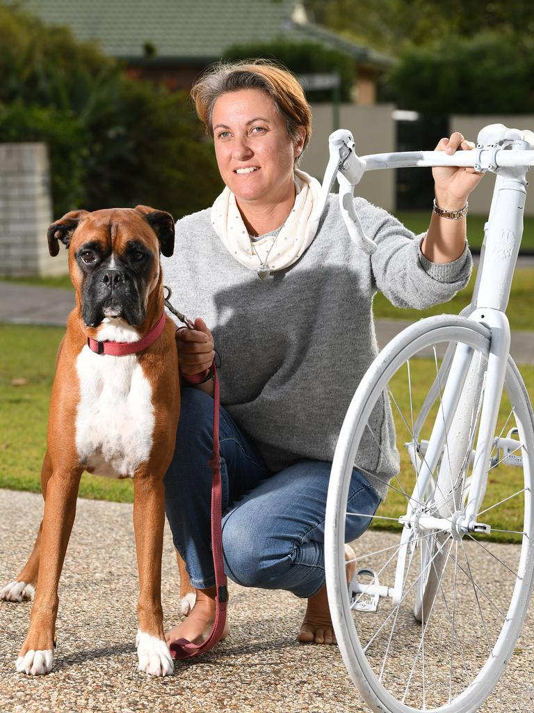 "Catherine Frewer and Herbie the boxer dog with Cameron's ""angel bike""."
