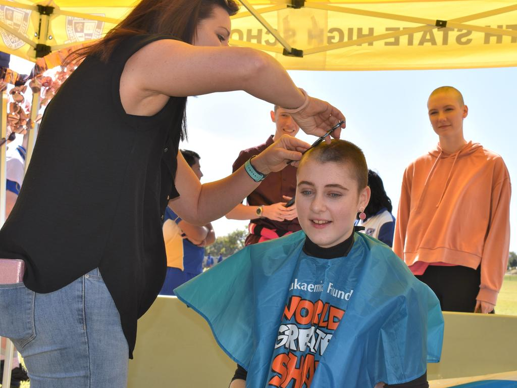 Mackay North State High School school captain Jana Bassan having her locks shaved off for the World's Greatest Shave. Picture: Heidi Petith