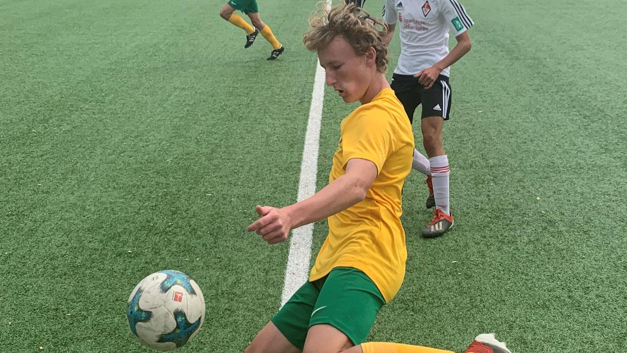 Will Hayes in action at the Fraser Coast Joeys Mini World Cup where he was selected to tour Germany. The tour led to a contact with football club Schmeltz FC and now with FC 08 Homburg.