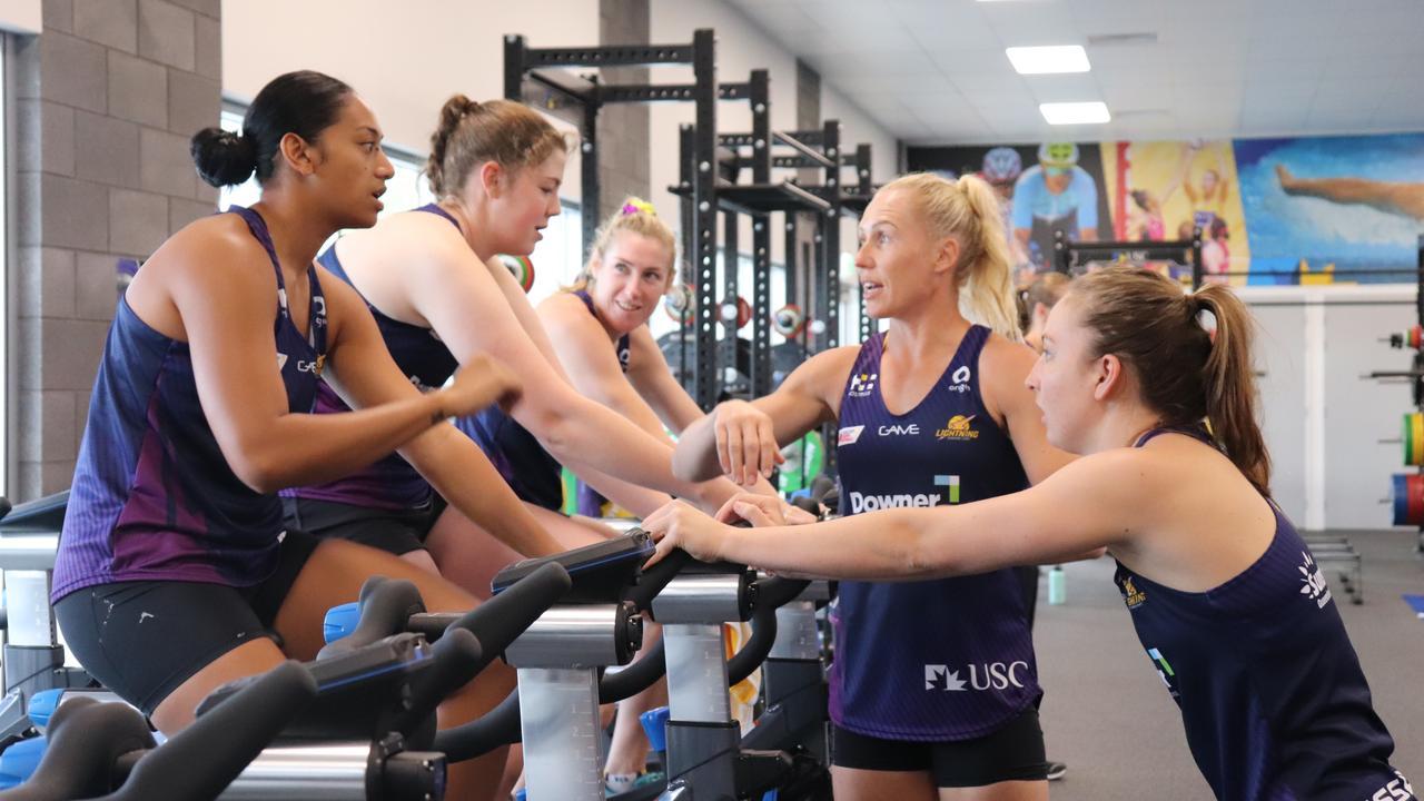Sunshine Coast Lightning captain Laura Langman speaks to training partners Ashlee Unie and Binnian Hunt. PHOTO: Eyes Wide Open Images / Barry Alsop