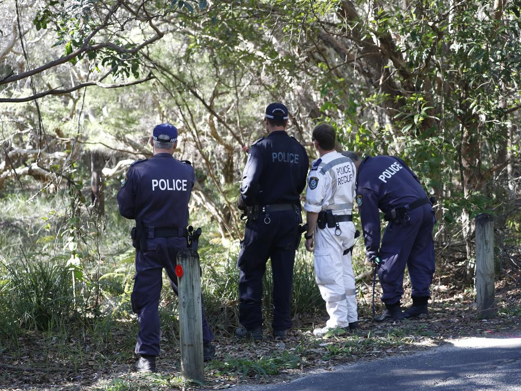 Police searching bushland along Tallow Beach Rd in the Arakwal National Park. Picture: Liana Turner