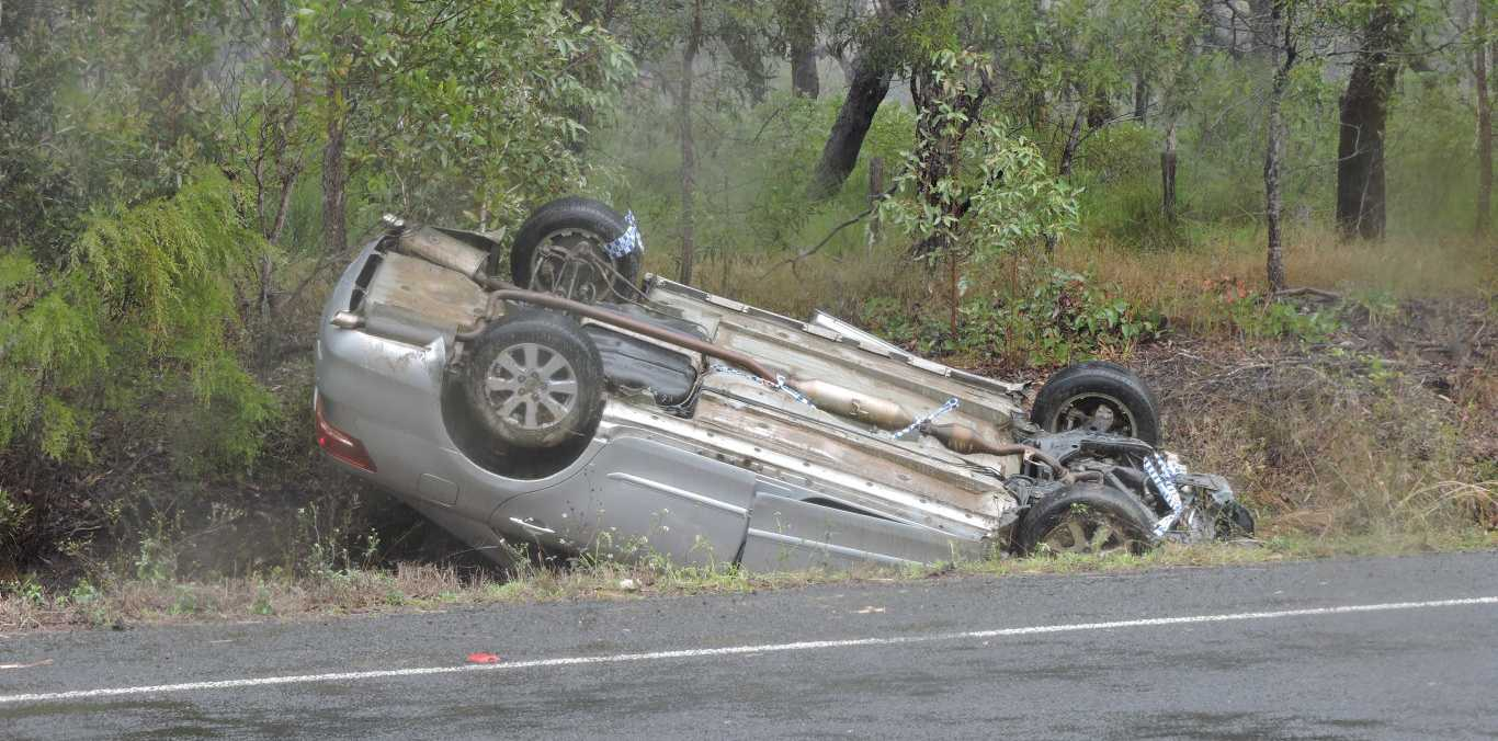 A car flipped on its roof beside Maryborough Hervey Bay Rd, near Susan River.