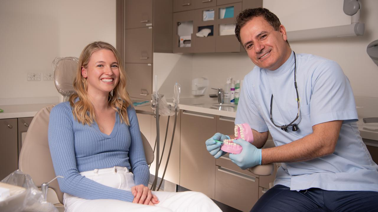 Dentist Joseph Badr and patient Bronwen Lifestyle photos of Bronwen Fielding-Trips on the dental chair. Smile dentistry who have launched a web page helping people get pro dental care. Picture: Jason Edwards