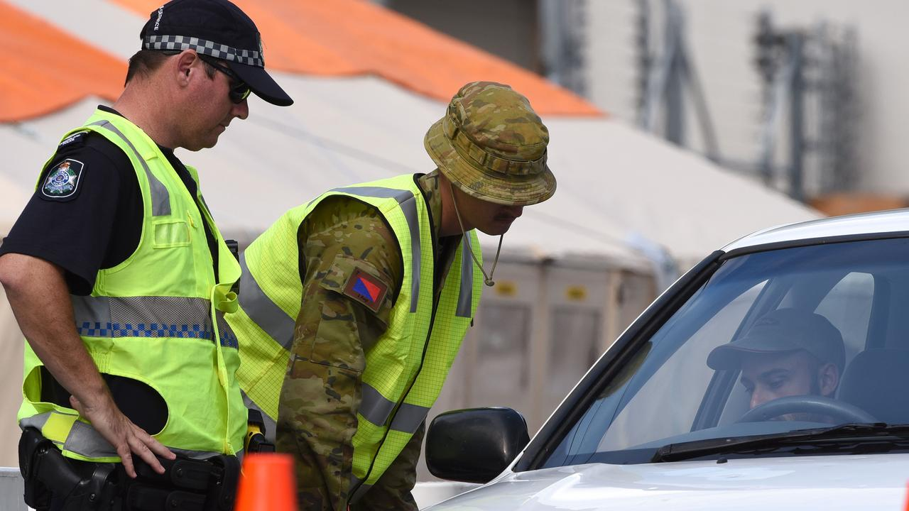 The man allegedly crossed the border using a fraudulent exemption pass and travelled to Gympie in May. Picture: Police check cars at a QLD border crossing / Steve Holland