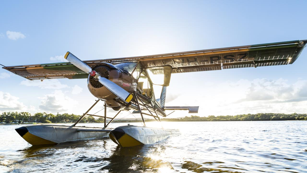WHAT A VIEW: The Paradise Seaplane in action over Pumicestone Passage.
