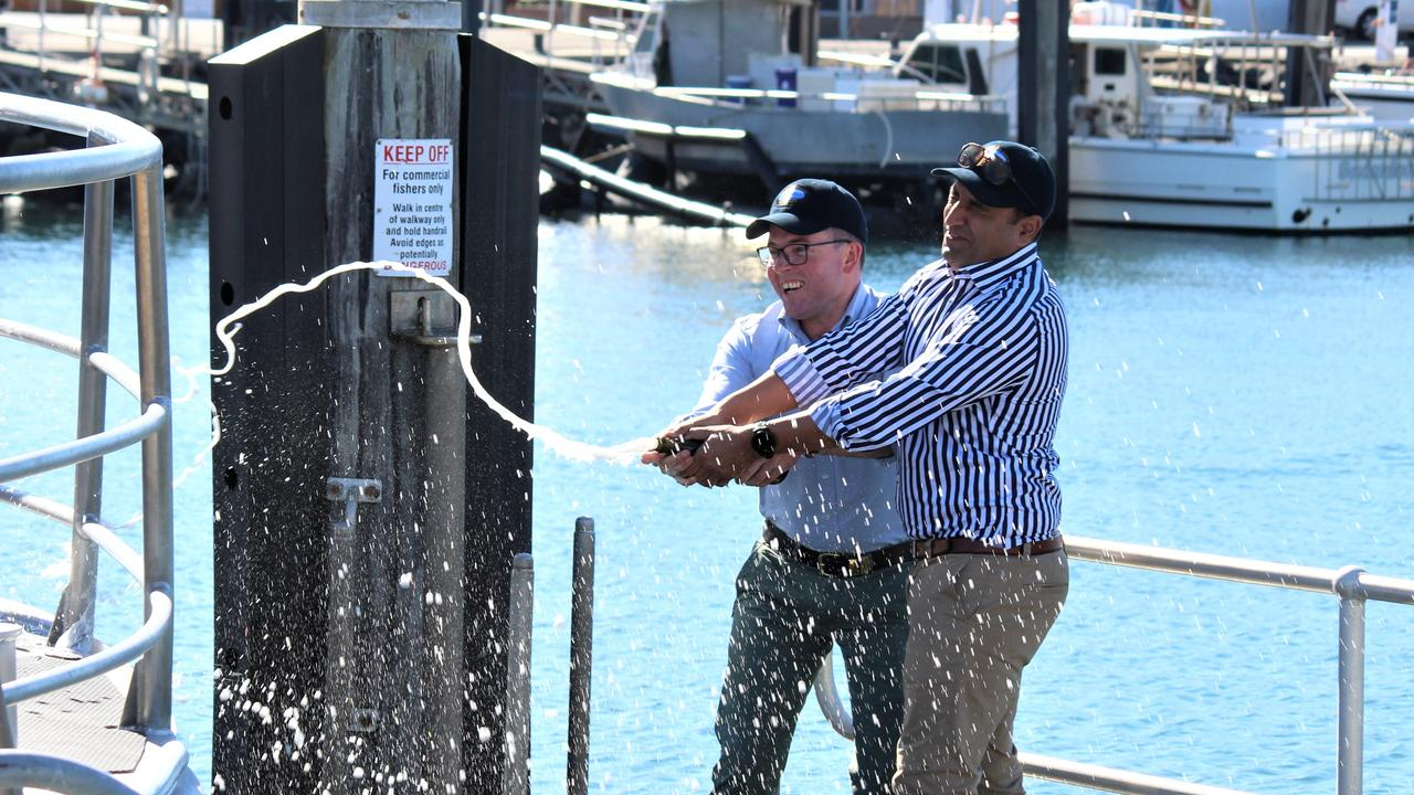 Coffs Harbour MP and NSW Agriculture Minister Adam Marshall spray champagne on the NSW Fisheries boat, Solitary Ranger at Coffs Harbour Marina. Photo: Tim Jarrett