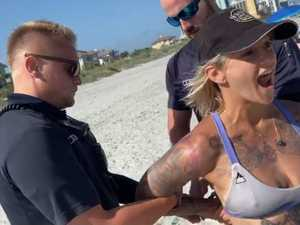 Woman handcuffed over skimpy bikini