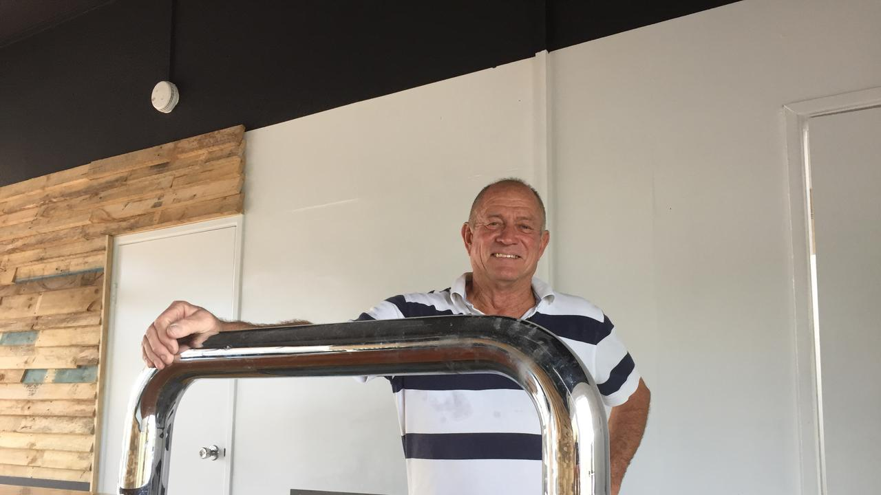 Mr Kidd behind what he hopes will soon be a popular bar.