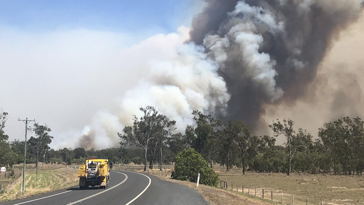 A fast-moving bushfire threatens property at Cobraball Road in November 2019.