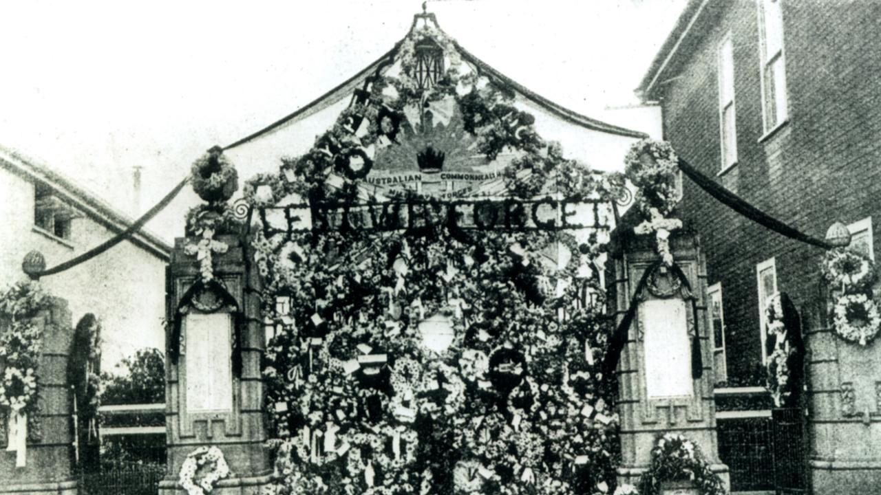 The Memorial Gates in Mary St were completely covered with wreaths for Anzac Day 1935.