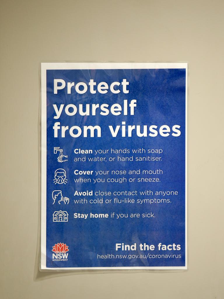 Coronavirus warning signage at the Domestic Terminal 2 at Sydney Airport. Picture: Jonathan Ng