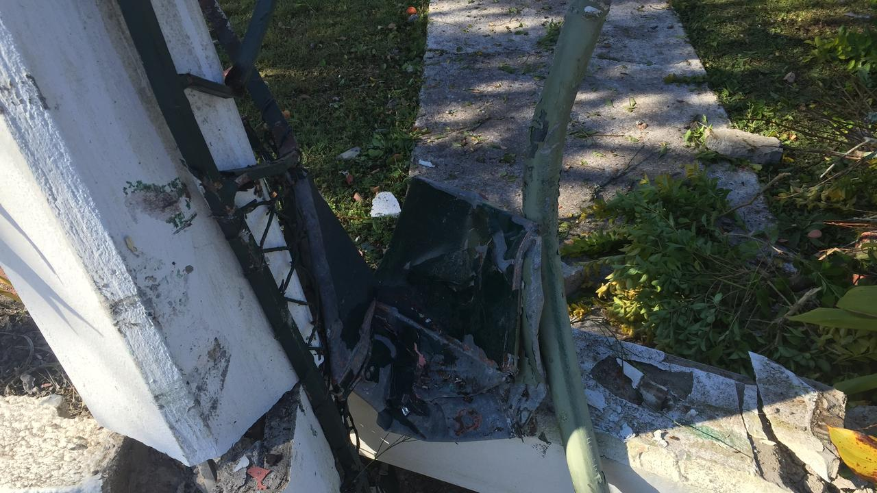 The front gate and letter box were obliterated in the crash.