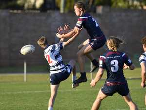 St Marys College player Riley Wockner (left) and