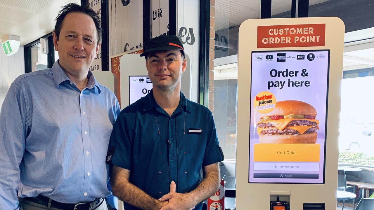 McDonalds restaurant owner Tony Ward, pictured with employee Shane Banks, said McDelivery is extremely safe option as it rolls out from tomorrow