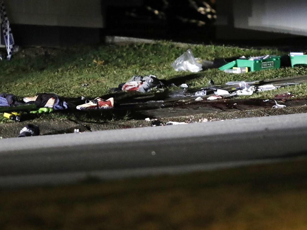 Objects are scattered across the footpath after the shooting in Upper Mt Gravatt, Brisbane. Picture: Josh Woning