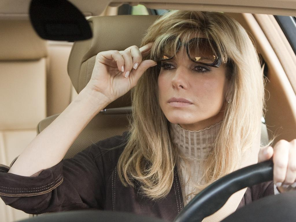 Sandra Bullock plays a feisty mother who helps a homeless teen in The Blind Side.