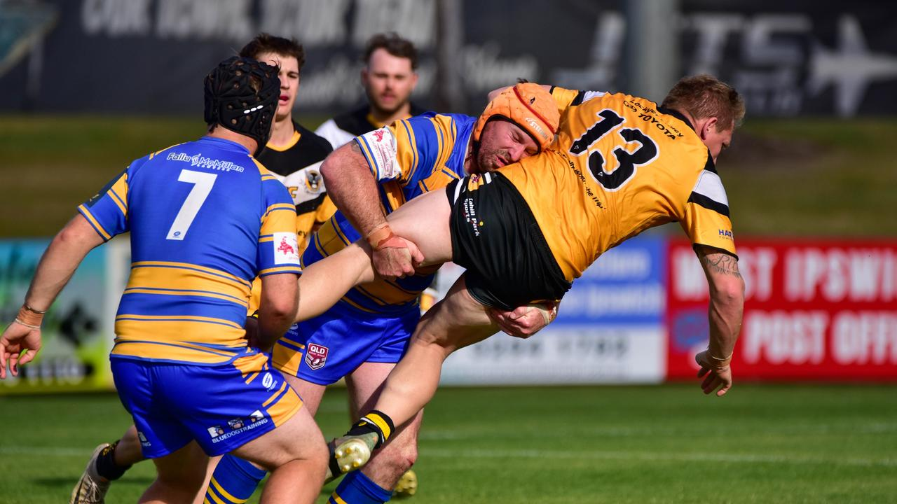 Gatton Hawks captain Shannon Hicks is driven back by the Norths defence in the first round of the Volunteers Cup competition. Picture: Bruce Clayton