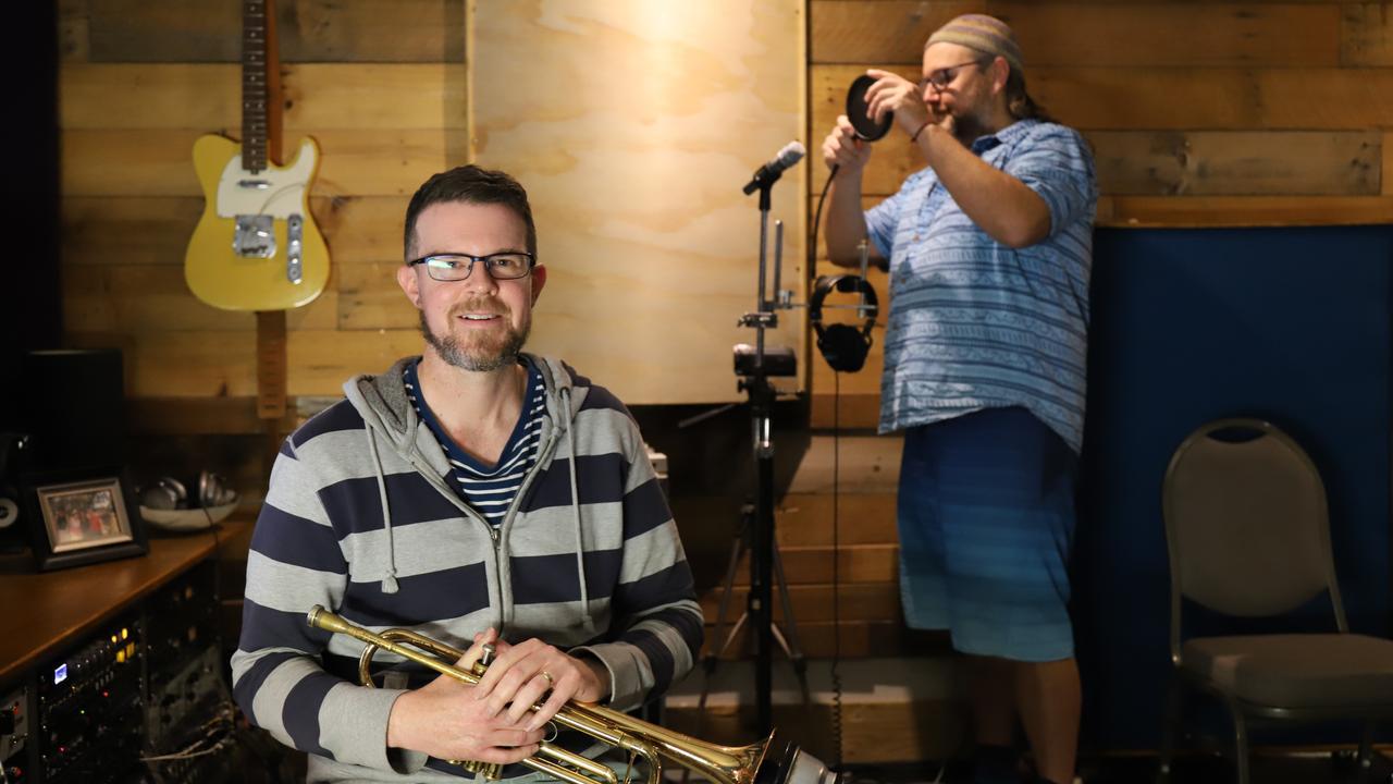 Mackay musician Matt Johnston at the Sugar Town Music studio with Scott Netuschil (right). Picture: Ashley Pillhofer