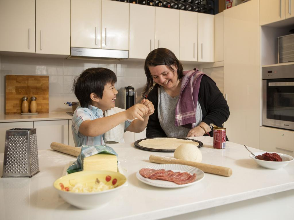 Serina Bird at home with her son Audie, 8, making pizza. Picture: Sean Davey.