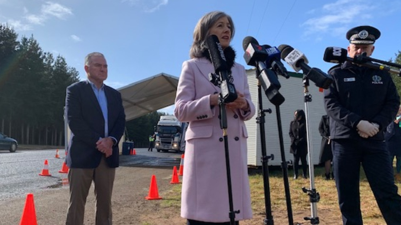 Chief public health officer Nicola Spurrier with health minister Stephen Wade and police commissioner Grant Stevens at the testing station at the SA Border checkpoint on the Princes Highway near Mount Gambier. Picture: Gretel Sneath