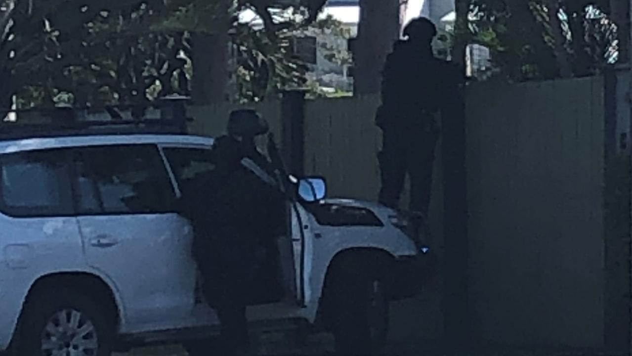 Multiple heavily-armed police attended the raid on Plucks Rd. Photo: Kara Sonter