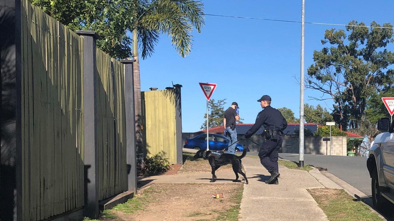 Police raid a house in Arana Hills. Photo: Kara Sonter