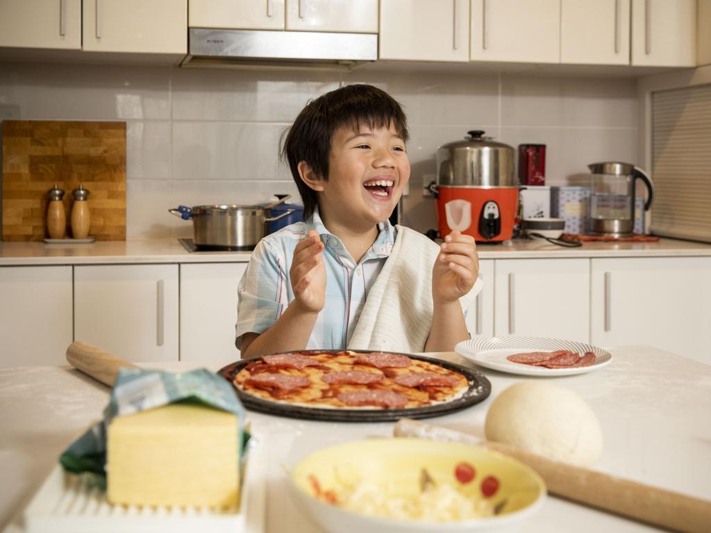 Serina Bird's Audie, 8, making pizza. Picture: Sean Davey