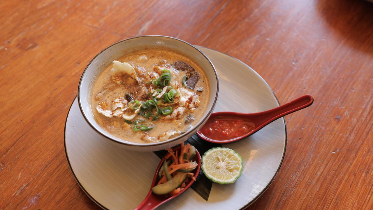 Challenging: Soto betawi soup with chunks of beef and beef lung at Sendok Garpu, Indooroopilly.Picture: Mark Cranitch.