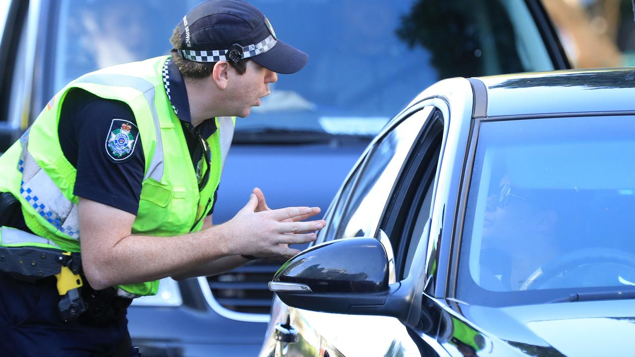 Police on duty at the Queensland border at Griffith Street Coolangatta which remains closed too to the Covid restrictions. Pics Adam Head