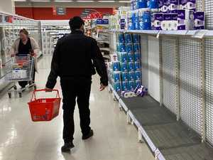 Supermarkets dismiss empty shelves as 'overbuying'