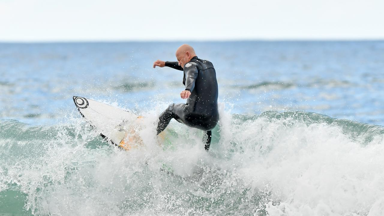 A surfer rides a wave at Alexandra Headland this week. Picture: Patrick Woods