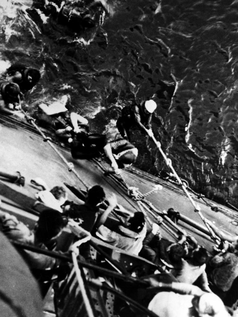 Survivors from the aircraft carrier USS Lexington are pulled aboard USS Minneapolis after their ship sank during the Battle of the Coral Sea.
