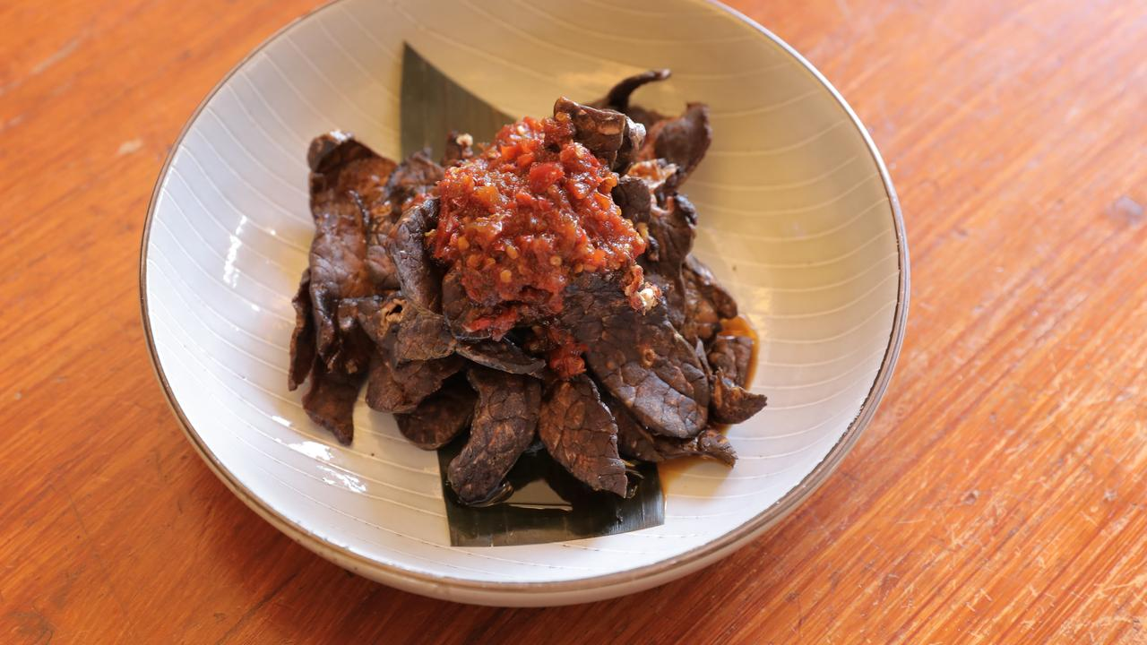 Hot: Paru balado, marinated and fried beef lung with sambal. Picture: Mark Cranitch.