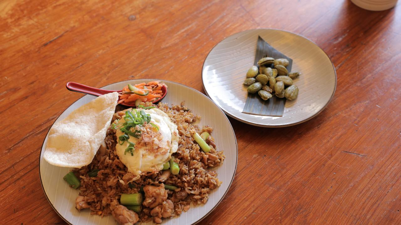 Delicious: Nasi goreng with chicken and a side of fried stinky beans. Picture: Mark Cranitch.
