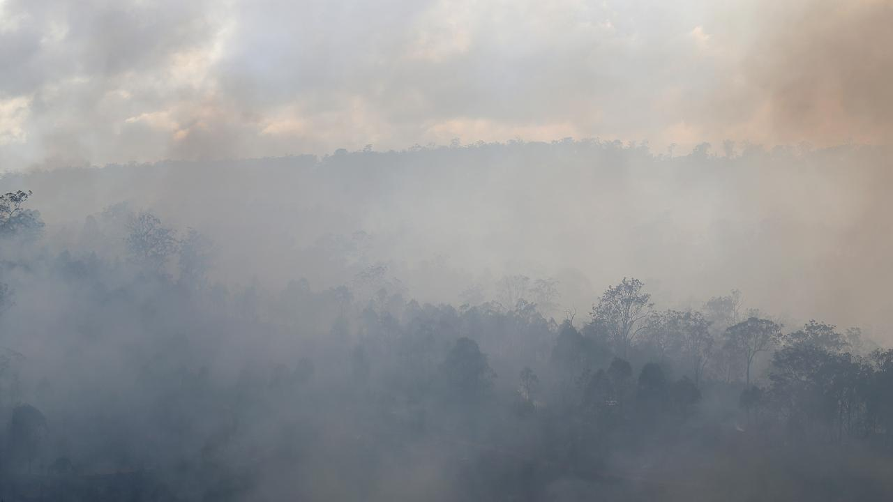 Fireys have been called to battle a 300m blaze burning at Ross Creek this afternoon. Pictures: Jack Tran / The Courier Mail