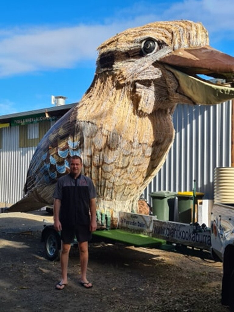QUICK FIX: Moore Park Beach mechanic Jason Wyllie has proven not heroes fly, after repairing the safety lights of the Giant Kookaburra.