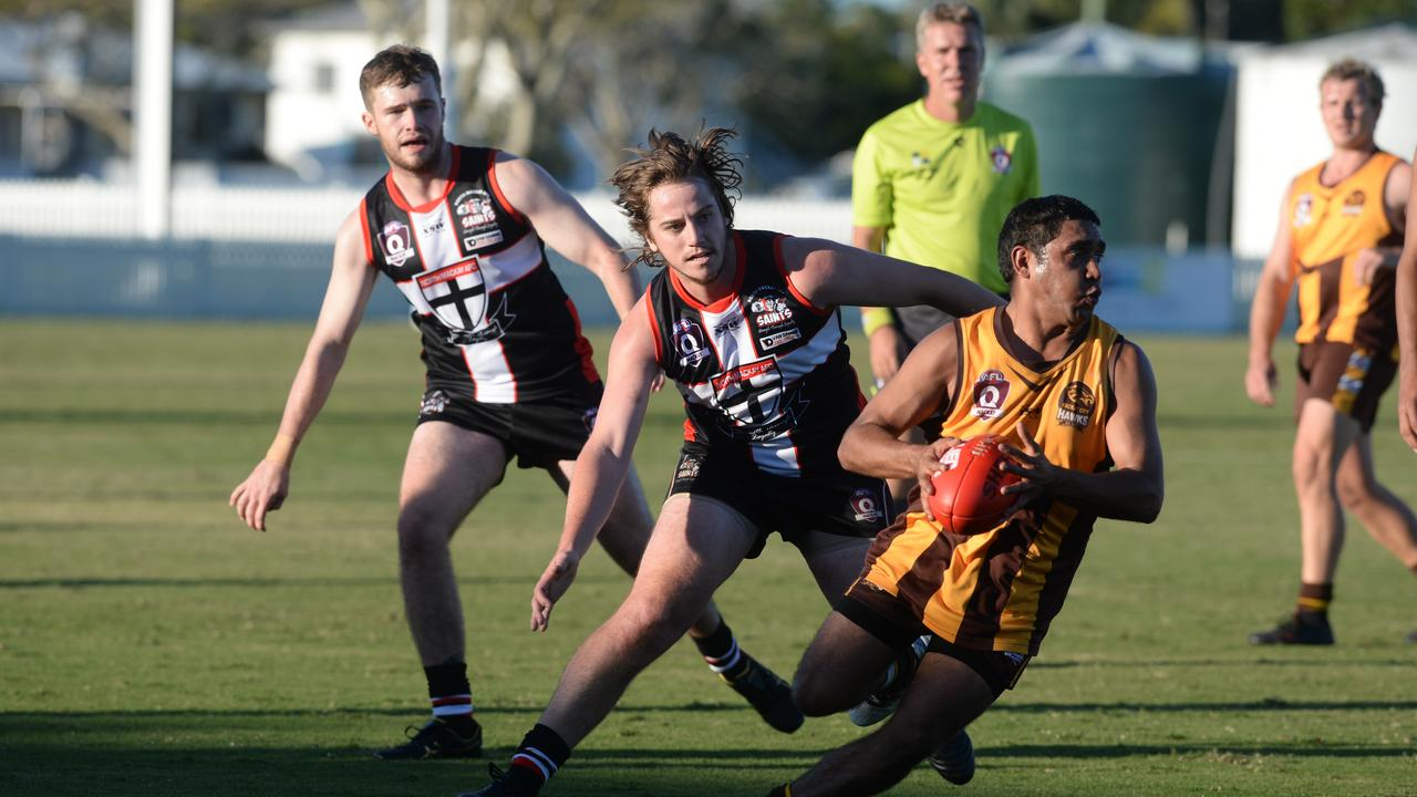 The North Mackay Saints 15.5-65 defeated Mackay City Hawks 7.4-46 in Round 2 of the AFL Mackay Allied Pickfords Cup at Great Barrier Reef Arena / Harrup Park. Saints' Jackson Perkins chases Hawks' Desmond Hayes. Photo: Callum Dick