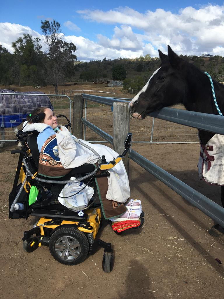 Abbie Sweeper with her horses during a special day trip back to her Lockyer Valley home.