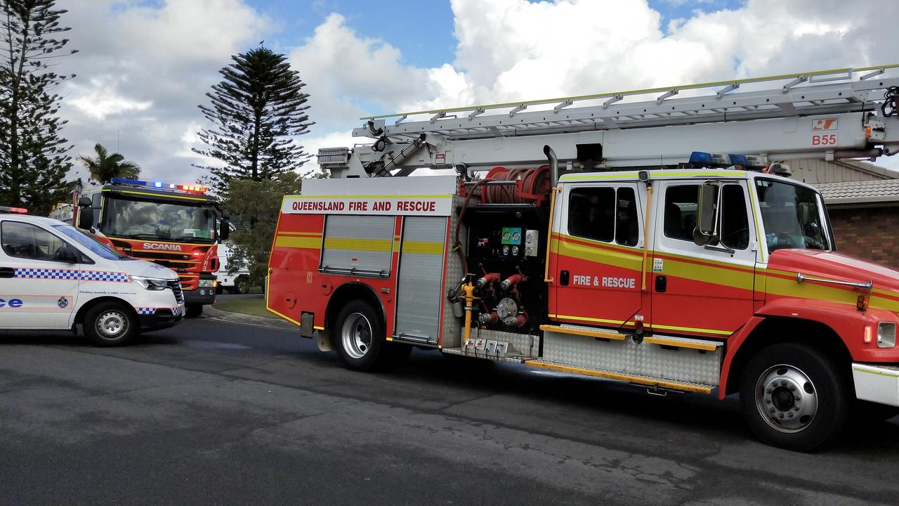 Firefighters at the scene of the explosion in Parkwood this morning. Picture: Jerad Williams.