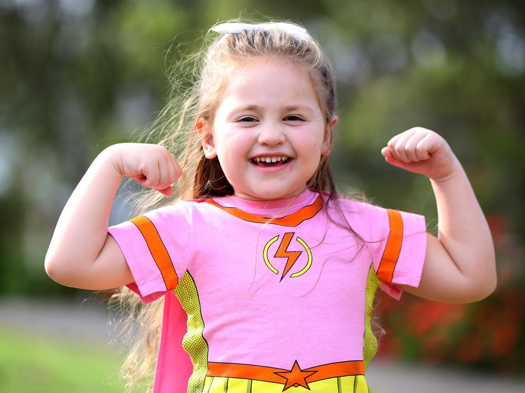 Angela, then five, posing in her Supertee shirt. Picture: AAP Image / Angelo Velardo